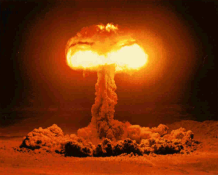 Color image of a ground-based atomic explosion and mushroom cloud