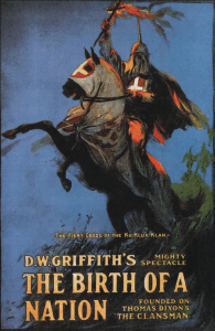 Image of the movie poster for the 1915 movie, The Birth of a Nation, directed by D.W. Griffith. Letters are at the bottom quarter of the image. The upper part of the image is a painting of a robed Klansman holding aloft a burning cross and sitting astride a rearing horse, also dressed in a Klan robe.