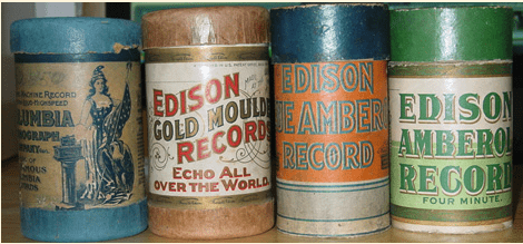 Image of four Edison Amberol cylinder recordings in a variety of original wrappers.