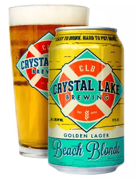 Photo of a full pint glass and a can of the Beach Blonde Golden Lager by the Crystal Lake Brewing Company