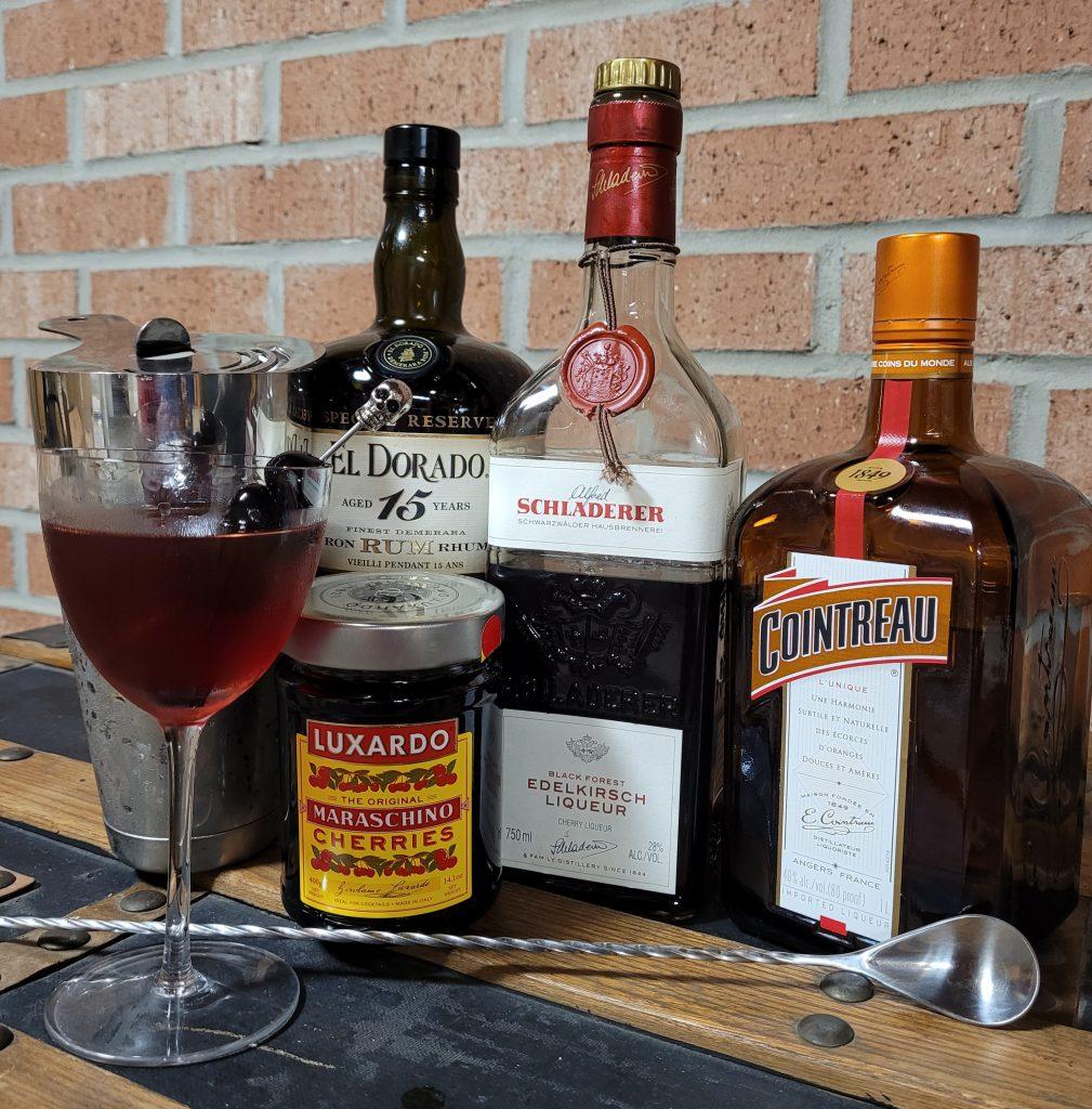 Mystery Drink ingredients: El Dorado 15 year special reserve, Schladerer Edel-Kirsch, Cointreau, Luxardo Maraschino Cherries